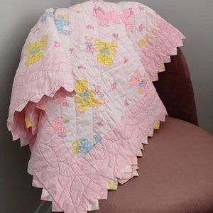 Vintage pink, blue, and yellow baby blanket quilt